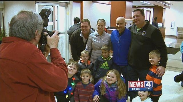Sgt Tom Lake (right) showed his appreciation for the community at a fundraiser for him at Bartolino's Thursday night. Credit: KMOV