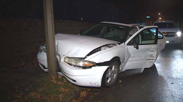 2 people were extricated from this car when it was hit from behind by another vehicle in North St. Louis. The other car drove away. Credit: KMOV