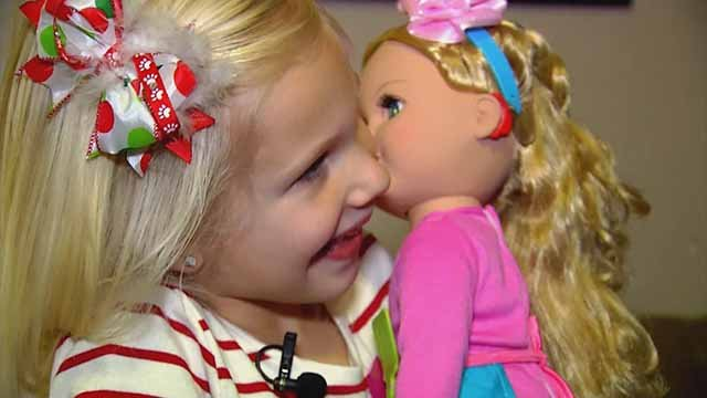 Harper, 6, was thrilled when she received a doll that has cochlear implants for Christmas. She has had cochlear implants since she was small. Credit: CBS