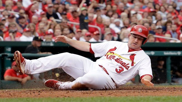 St. Louis Cardinals' Jedd Gyorko scores during the seventh inning of a baseball game against the Pittsburgh Pirates, Sunday, Oct. 2, 2016, in St. Louis. (AP Photo/Jeff Roberson)
