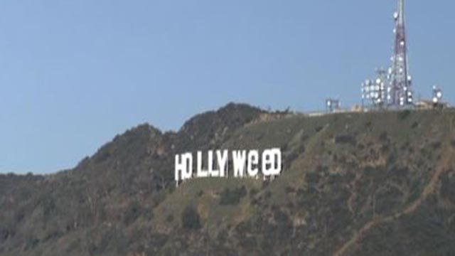 "Vandals altered the Hollywood sign to read ""Hollyweed"" (Credit: CBS)"