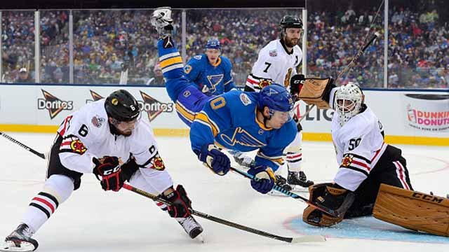 Scottie Upshall #10 of the St. Louis Blues is upended during the 2017 Bridgestone NHL Winter Classic against the Chicago Blackhawks at Busch Stadium on January 2, 2017 in St Louis, Missouri. (Photo by Patrick McDermott/NHLI via Getty Images)