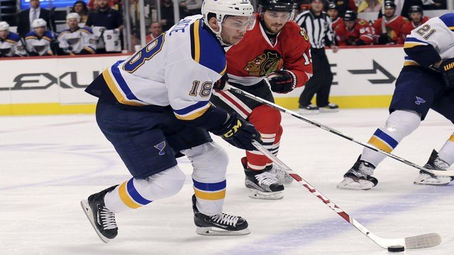 St. Louis Blues right wing Ty Rattie (18) is defended by Chicago Blackhawks center Artem Anisimov (15) during the first period of an NHL hockey preseason game Saturday, Oct. 1, 2016, in Chicago. (AP Photo/David Banks)