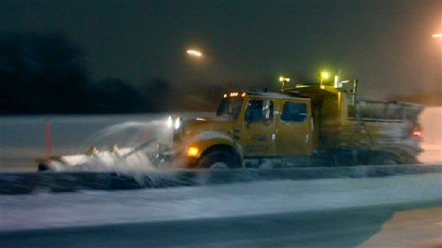 A Missouri Department of Transportation plow clears snow along I-70 near Kansas City, Mo., Tuesday, Feb. 1, 2011. I-70 was closed from Kansas City to St. Louis because of heavy snow. The area is under a blizzard warning. (AP Photo/Orlin Wagner)