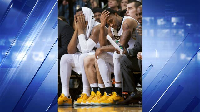 Missouri's Kevin Puryear, left, and Russell Woods, right, grimace as they watch their team play during the final minute of their 88-77 loss to LSU in a college basketball game Wednesday, Jan. 4, 2017, in Columbia, Mo. LSU won the game 88-77. (AP Photo)