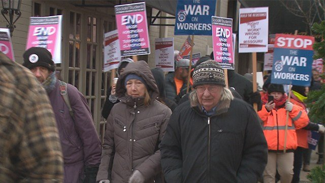 Protesters marched through the Central West End regarding potential right-to-work legislation. (Credit: KMOV).