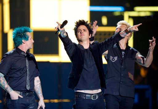 Green Day receive the Global Icon Award, during the MTV European Music Awards 2016, in Rotterdam, Netherlands, Sunday, Nov. 6, 2016. (AP Photo/Peter Dejong)