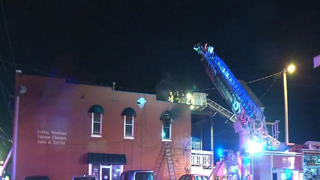 Firefighters extinguishing a fire at First Capitol & Fifth Street Monday in St. Charles. (Credit: KMOV)