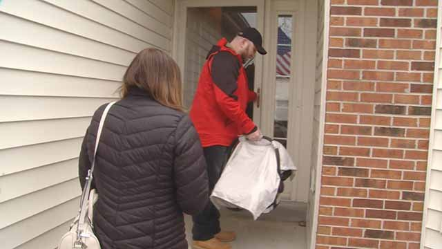Staff Sergeant Jason Beisner was handed the keys to a new home in Swansea by Wells Fargo Wednesday. Credit: KMOV