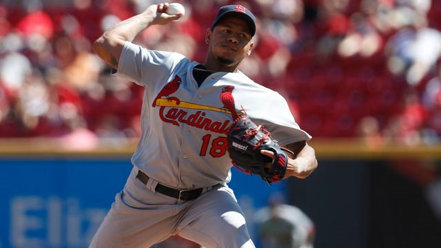 Carlos Martinez and Michael Wacha still need contracts for the upcoming season, but one is in line to profit much more than the other. (AP Photo/John Minchillo)