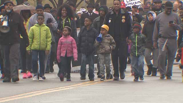 People march in the annual MLK Day Parade in downtown St. Louis. Credit: KMOV