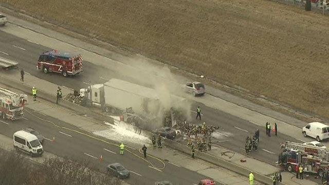 Skyzoom 4 over scene of crash, semi-truck fire on SB I-270 Tuesday (Credit: KMOV)