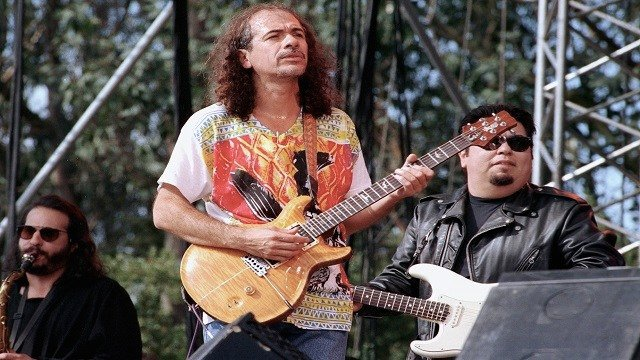 Rock guitarist Carlos Santana, center, performs with Cesar Rosas, guitarist with rock group Lobo Los, during a tribute concert to legendary rock promoter Bill Graham at San Francisco's Golden Gate Park. (Credit: AP Photo/Olga Shalygin)