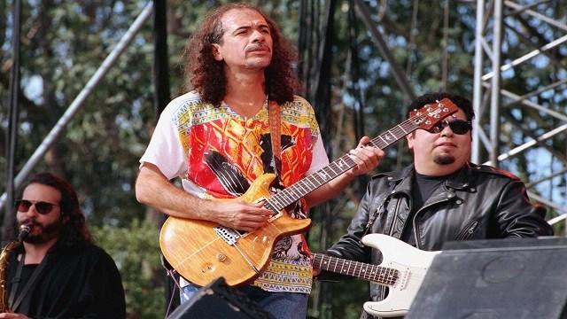 Rock guitarist Carlos Santana, center, performs with Cesar Rosas, guitarist with rock group Lobo Los, during a tribute concert to legendary rock promoter Bill Graham at San Francisco's Golden Gate Park. (Credit: AP Photo/Olga Shalygin)