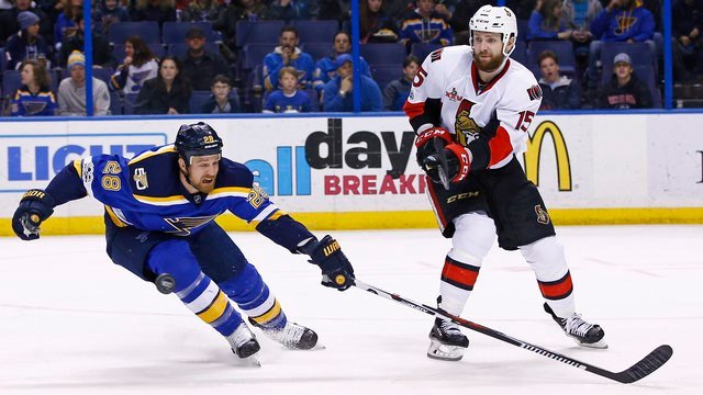St. Louis Blues' Kyle Brodziak, left, reaches to deflect a pass by Ottawa Senators' Zack Smith during the second period of an NHL hockey game Tuesday, Jan. 17, 2017, in St. Louis. (AP Photo/Billy Hurst)