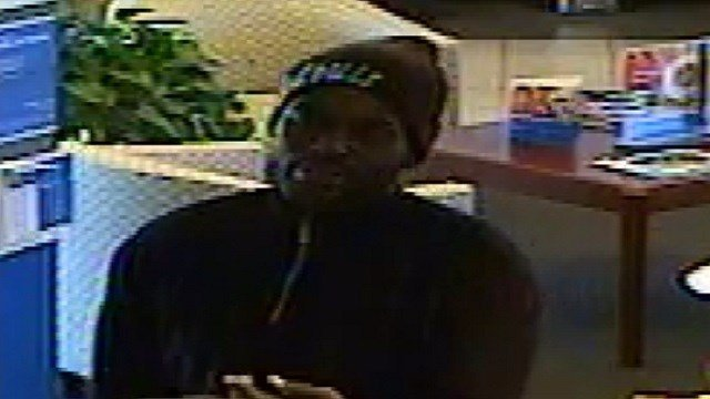 This male suspect implied he had a gun, and robbed the bank of an undisclosed amount of money. (Credit: Creve Coeur Police)