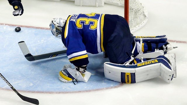 St. Louis Blues goalie Jake Allen is slow to get up after giving up a goal to Washington Capitals' T.J. Oshie during the second period of an NHL hockey game Thursday, Jan. 19, 2017, in St. Louis. (AP Photo/Jeff Roberson)