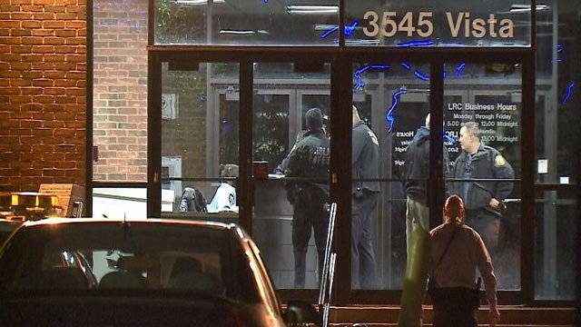 Officers inside the Learning Resource Center as the SLU campus was ordered to shelter-in-place Monday (Credit: KMOV)