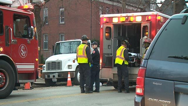Paramedics outside McKinley School after a child was hit by a vehicle Tuesday (Credit: KMOV)