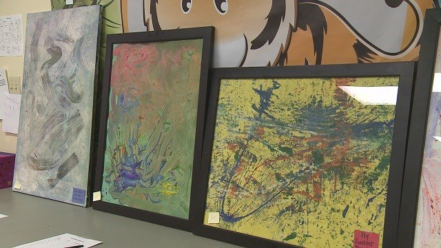 Art show underway to raise money for BackStoppers. (Credit: KMOV)