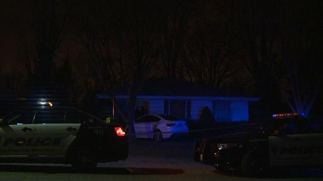 Police on the scene of a home in the 1350 block of Shepley Drive in Bellefontaine Neighbors (Credit: KMOV)