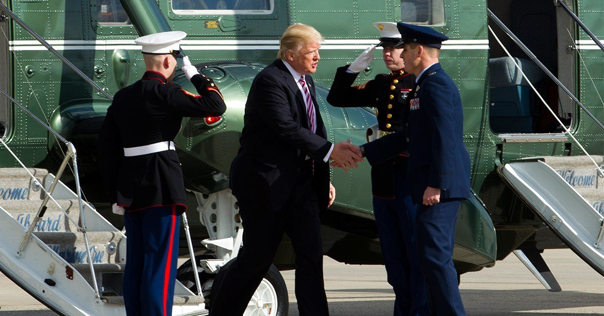 President Donald Trump is welcomed by Col. Christopher M. Thompson, Vice Commander, 89th Airlift Wing, upon his arrival at Andrews Air Force One, Md. aboard Marine One, Thursday, Jan. 26, 2017. ( AP Photo/Jose Luis Magana)