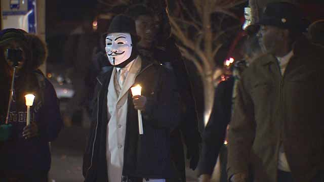 A protester in a mask. Credit: KMOV