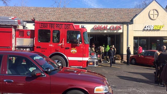 A car crashed into the Great Clips on Bayless Thursday (Credit: KMOV)