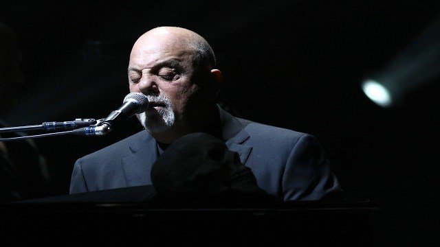 Billy Joel performs in concert at Madison Square Garden on Friday, October 28, 2016, in New York. (Photo by Greg Allen/Invision/AP)