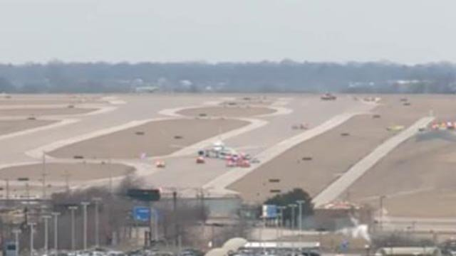 Emergency crews on the runway after an American Airlines flight landed Thursday (Credit: KMOV)