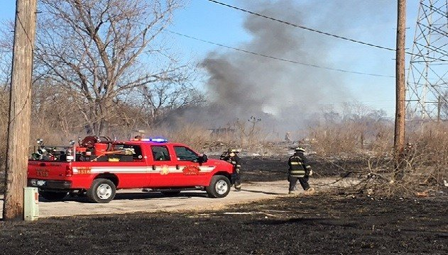 Multiple fire crews responded to a brush fire in East St. Louis on Sunday. (Credit:KMOV)