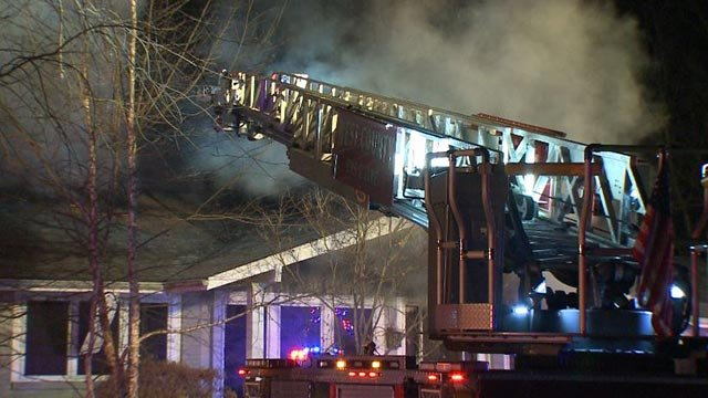 Fire crews battling a blaze at Posthorn and Big Bend Woods in Manchester Monday (Credit: KMOV)