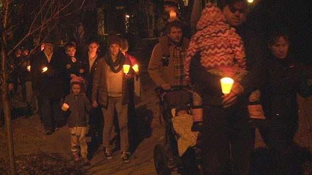 Dozens gather to man shot and killed Friday night in Tower Grove South neighborhood. (Credit:KMOV)