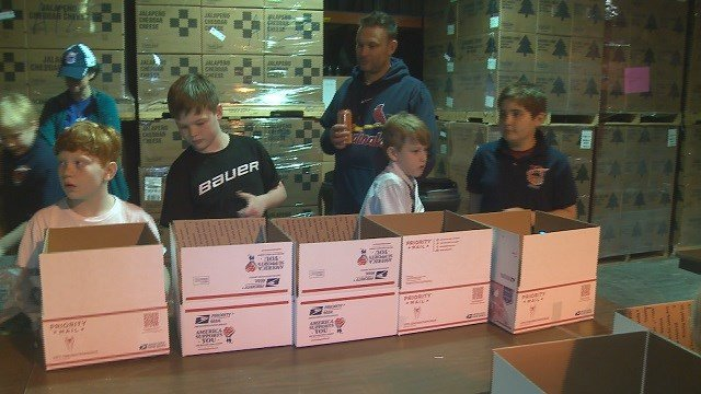 A group of fourth and fifth grade hockey players are taking a break from their time on the ice to help members of the military serving overseas. (Credit: KMOV)