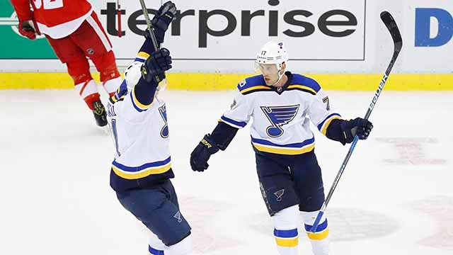 St. Louis Blues left wing Jaden Schwartz, right, celebrates his empty net goal against the Detroit Red Wings with Vladimir Tarasenko in the third period of an NHL hockey game Wednesday, Feb. 15, 2017, in Detroit. St. Louis won 2-0. (AP Photo/Paul Sancya)