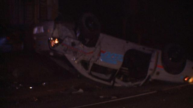 A St. Clair County Sheriff Deputy's squad car overturned in East St. Louis Friday (Credit: KMOV)