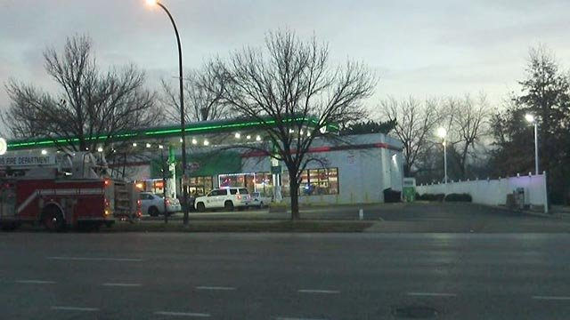 Multiple emergency vehicles were seen at a BP gas station on West Florissant after a man was shot Monday (Credit: KMOV)