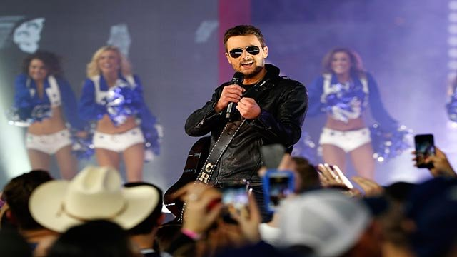Country music singer Eric Church performs at halftime during an NFL football game between the Washington Redskins and Dallas Cowboys on Thursday, Nov. 24, 2016, in Arlington, Texas. (AP Photo/Ron Jenkins)