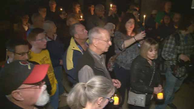 People gathered for a vigil outside Chesed Chel Emeth Cemetery in University City after it was vandalized. Credit: KMOV