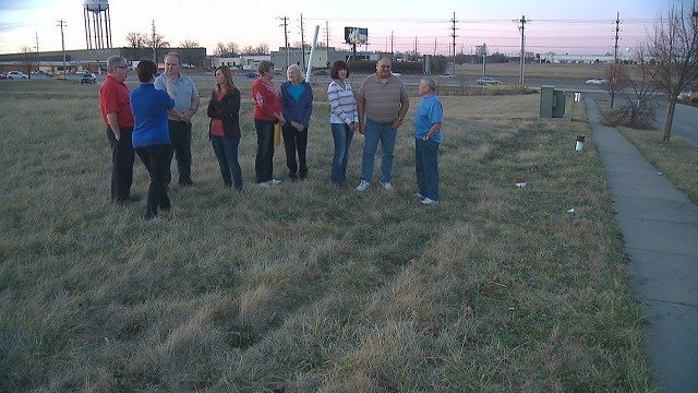 Residents meet in lot where potential hotel would be built. (Credit: KMOV)