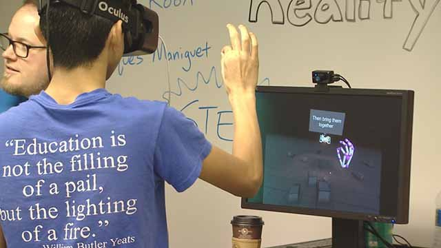 Students use virtual reality gear during high-tech day at AT&T's officers in downtown STL. Credit: KMOV