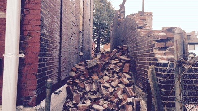 Andrew Johnson said piles of bricks from a torn down home next door was left there after the demolition. (Credit: KMOV)