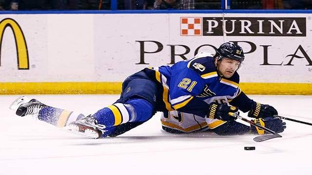 St. Louis Blues' Patrik Berglund, front, of Sweden, becomes entangled with Nashville Predators' Craig Smith as they battle for the puck during the third period of an NHL hockey game Friday, Dec. 30, 2016 (Credit: AP Photo / Billy Hurst)