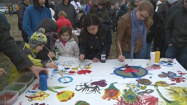 University City residents unite at rally, put together art project. (Credit: KMOV)