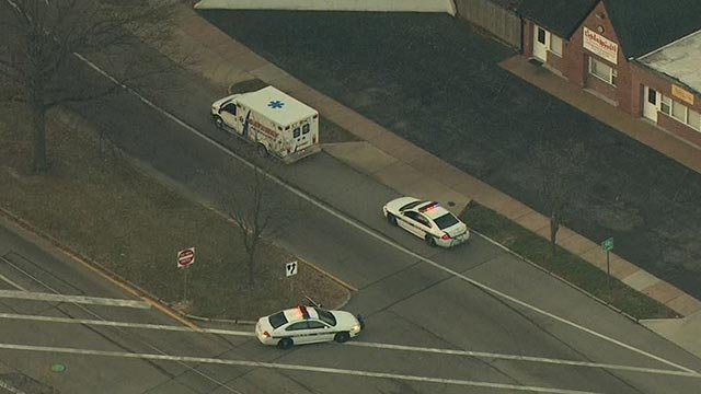 An ambulance & police vehicles at Midland & Vernon after a bicyclist was struck (Credit: KMOV)