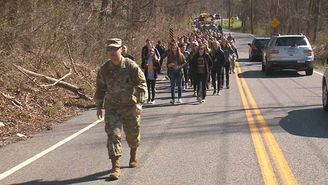 Students from Seckman and Windsor High Schools walked down Seckman Road in Jefferson County to help victims of the Perryville tornado. Credit: KMOV