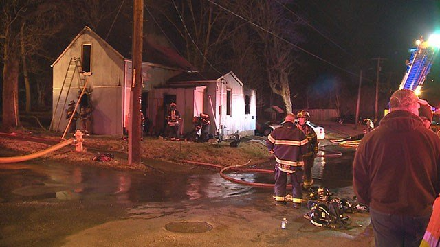 Fire crews said house is a total loss after flames engulfed Collinsville home. (Credit: KMOV)