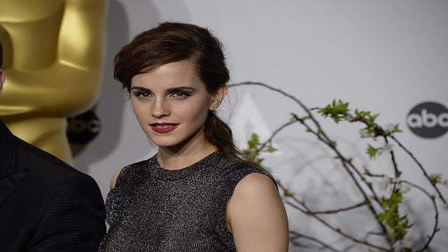 Emma Watson poses in the press room during the 86th Academy Awards on March 2, 2014. (Credit: Wen-Chun Fan/CNN)