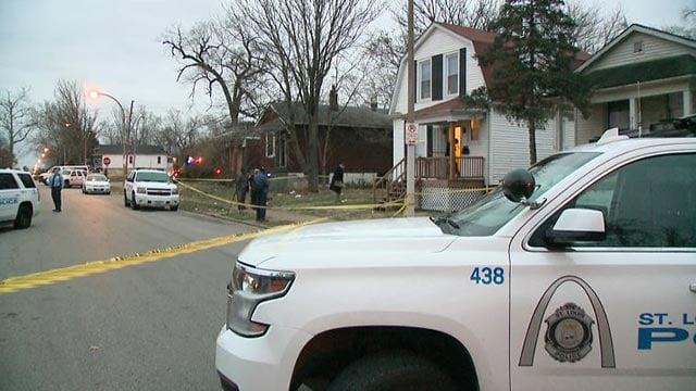 Homicide investigators in the 4900 block of Thrush Avenue Monday (Credit: KMOV)