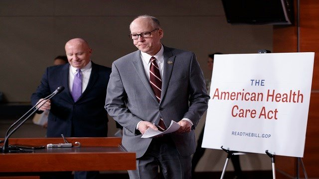 House Ways and Means Committee Chairman Rep, Kevin Brady, R-Texas, left, follows House Energy and Commerce Committee Chairman Rep. Greg Walden, R-Ore. to a news conference on Capitol Hill. (AP Photo/J. Scott Applewhite)